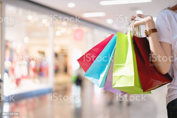 Closeup of woman holding shopping colorful of shopping bags at mall picture id957125704?b=1&k=6&m=957125704&s=612x612&h=rbnxi95fk cch2kor58npbili7le44 71tj0rrsjgwe=