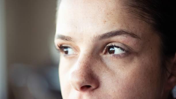 Closeup of woman looking away stock photo