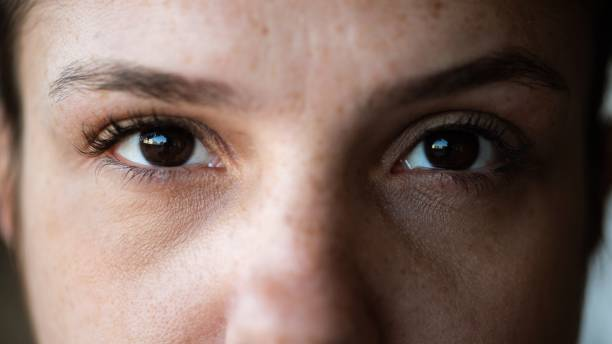 Closeup of woman looking directly at the camera stock photo
