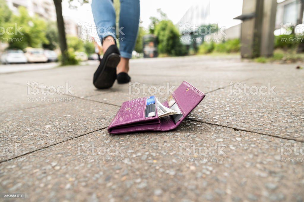Close-up Of Woman Losing His Wallet stock photo