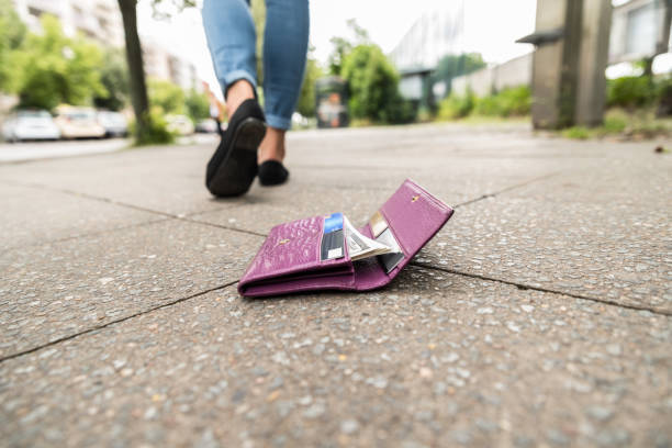 close-up of woman losing his wallet - lost stock photos and pictures