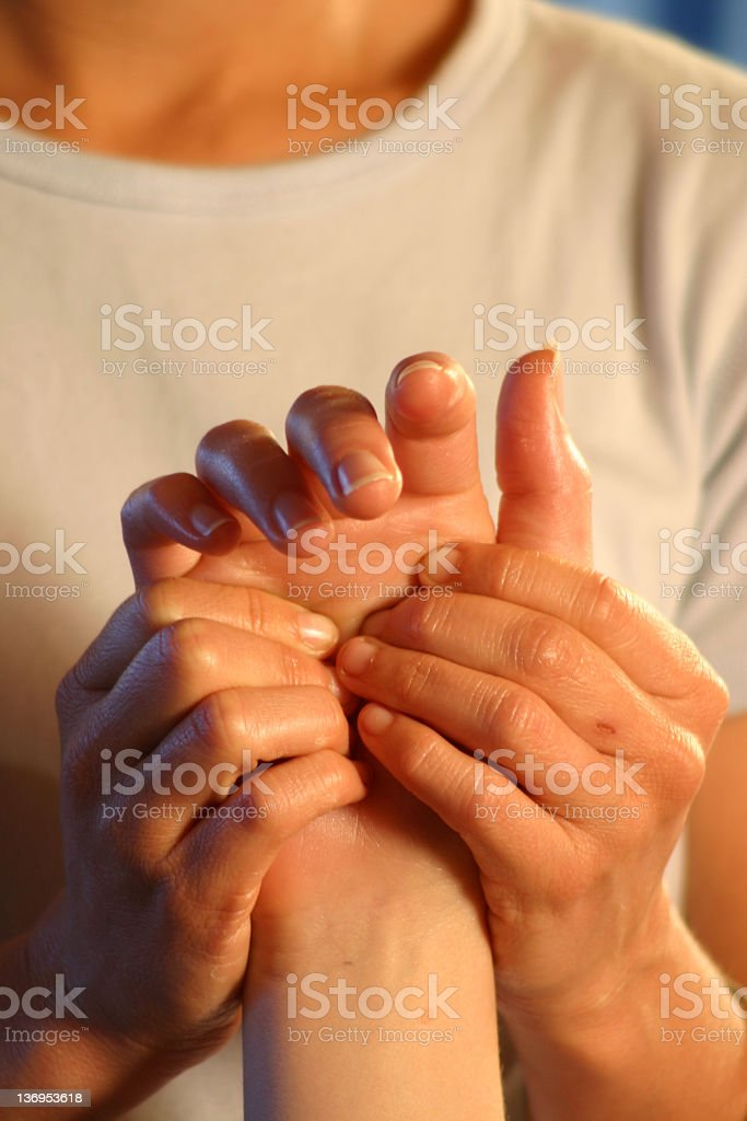 Closeup of woman masseuse massaging man's hand royalty-free stock photo
