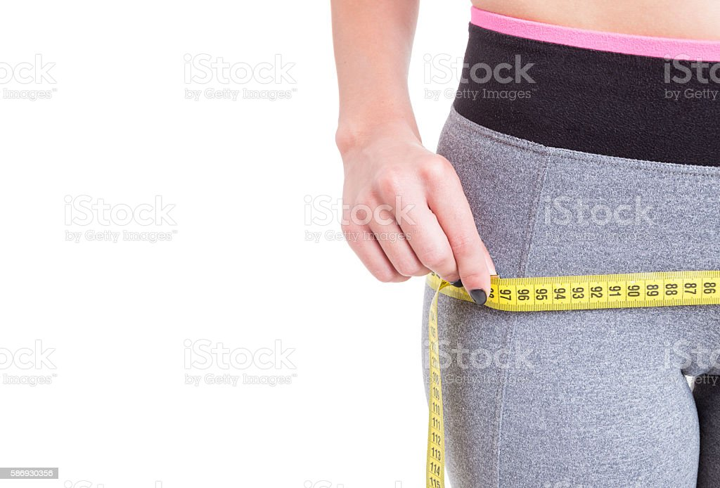 Close-up of woman measuring with tape line stock photo