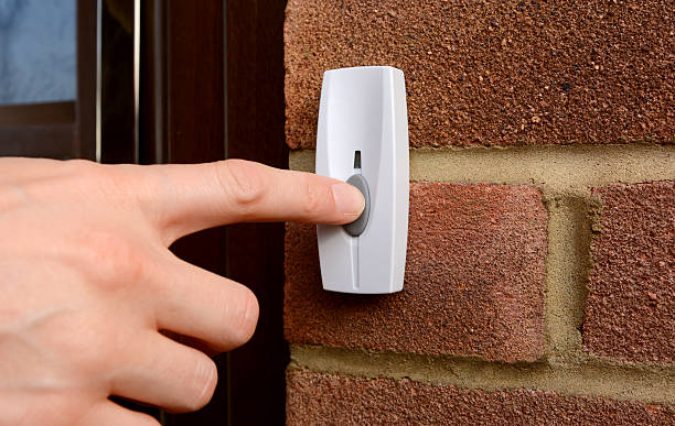 close-up of woman pressing a doorbell - ringklocka bildbanksfoton och bilder