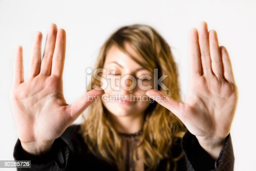 istock Close-up of woman putting palms up implying no more 92285726