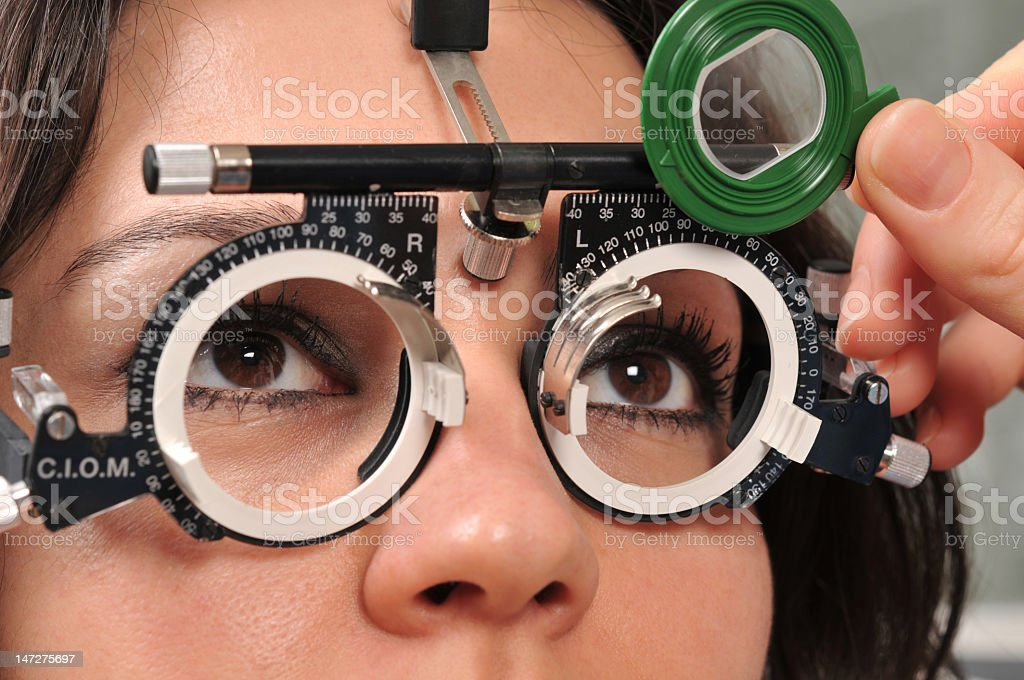 Close-up of woman receiving eye exam royalty-free stock photo
