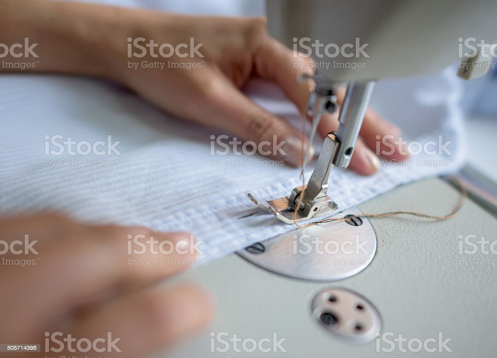 Close-up of woman sewing stock photo