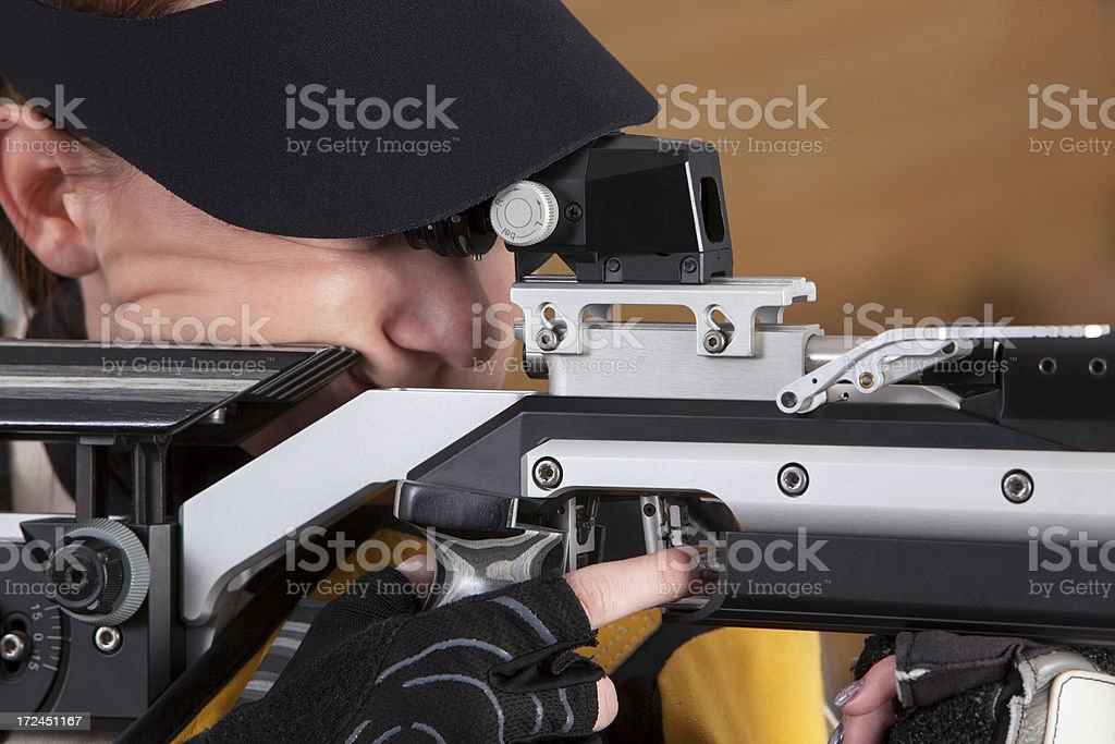 Close-up Of woman Shooting Target royalty-free stock photo