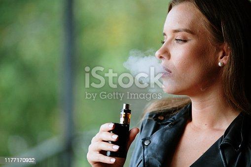 Closeup of woman smoking electronic cigarette