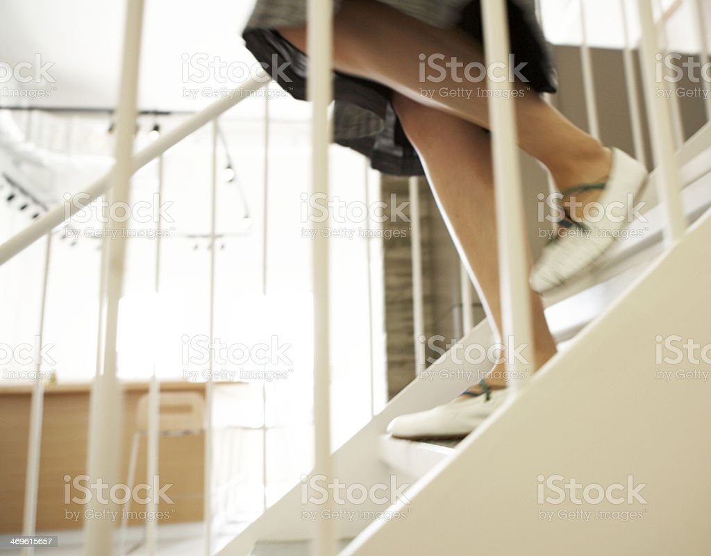 Close-Up of Woman Walking Down Steps stock photo