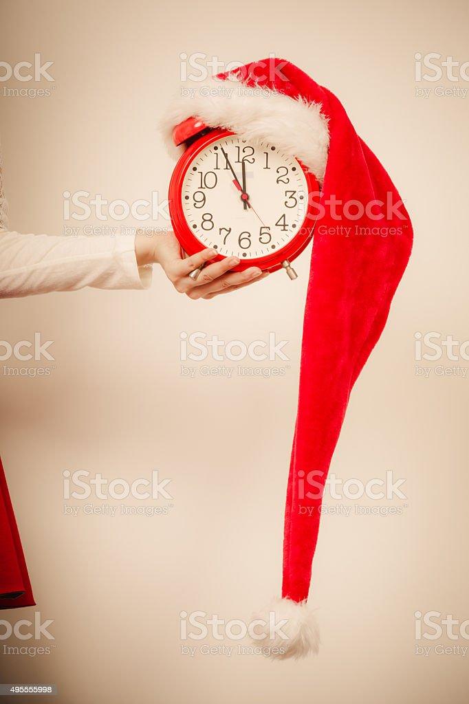 Closeup of woman with alarm clock. Christmas time. stock photo
