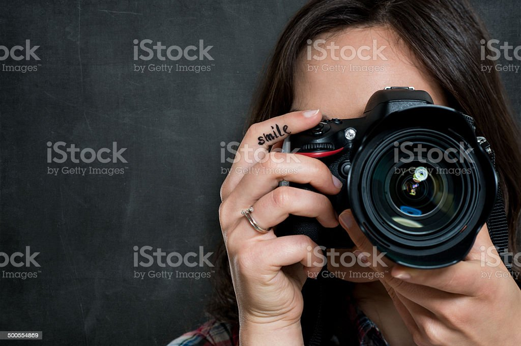Closeup Of Woman With Camera stock photo