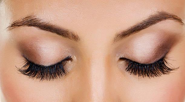 Closeup of woman with long eyelashes Closeup of woman with long eyelashes  false eyelash stock pictures, royalty-free photos & images