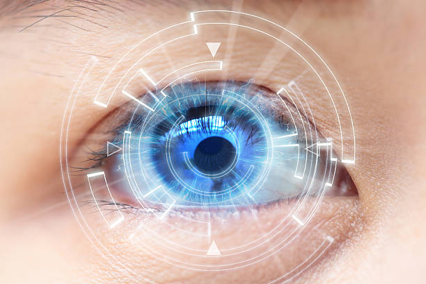 Close-up of woman's blue eye. High Technologies, contact lens stock photo