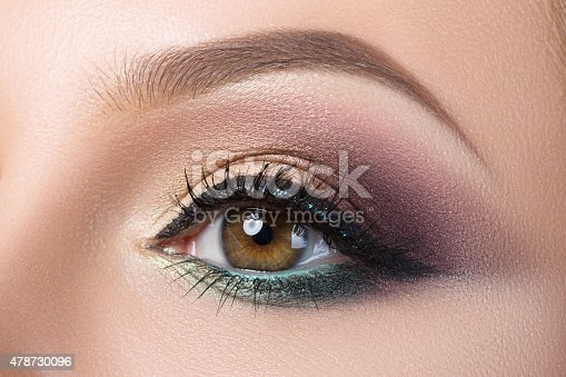 istock Close-up of woman's eye with creative modern make-up 478730096