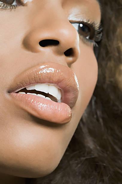 close-up of woman's face - verleiding stockfoto's en -beelden