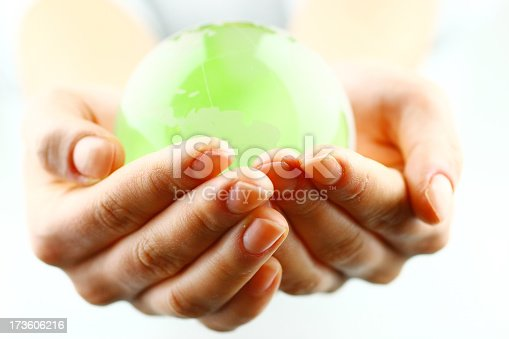 istock Close-up of woman's hands holding a bright green globe 173606216