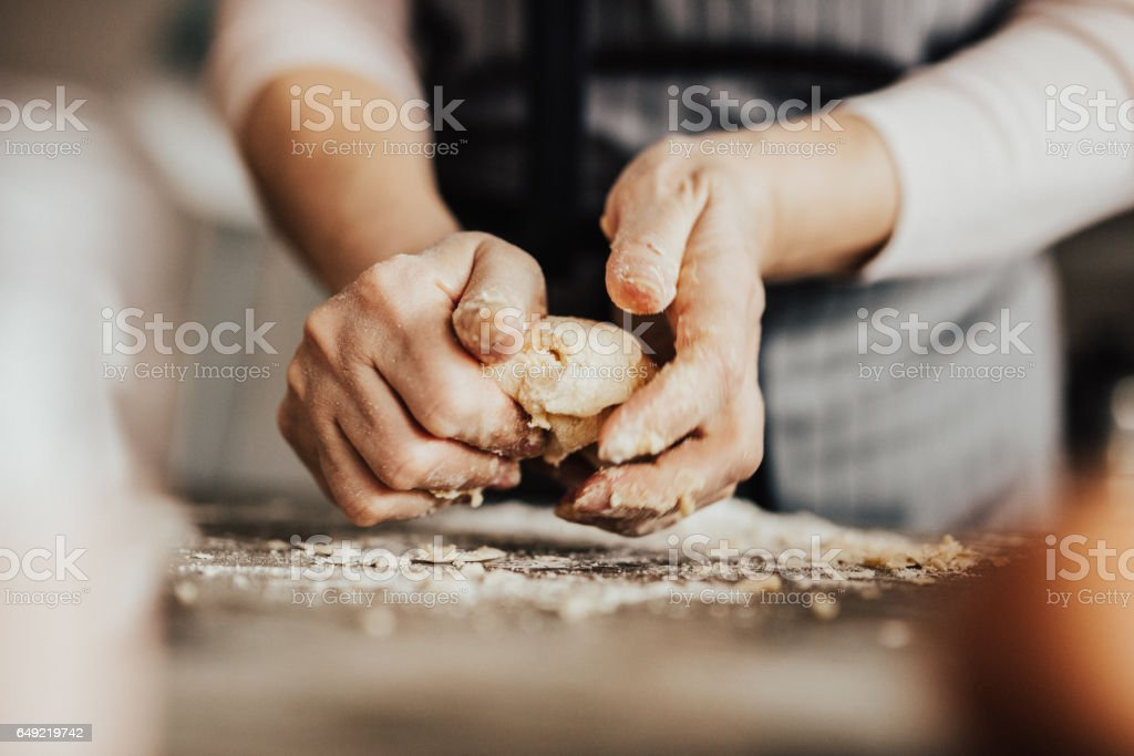Close-up of woman's hands kneading dough royalty-free stock photo