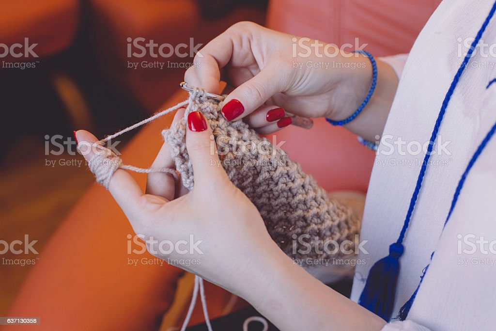 Close-up of woman's hands knitting stock photo
