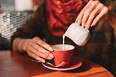 Picture of woman pouring milk into a cup