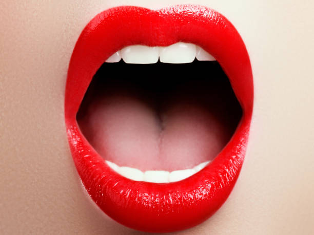 Close-up of woman's lips with fashion red make-up. Beautiful female mouth, full lips with perfect makeup - foto stock