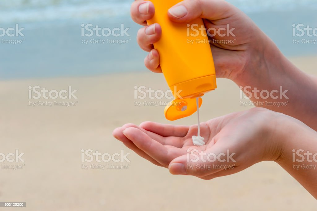close-up of women's hands with sunscreen stock photo