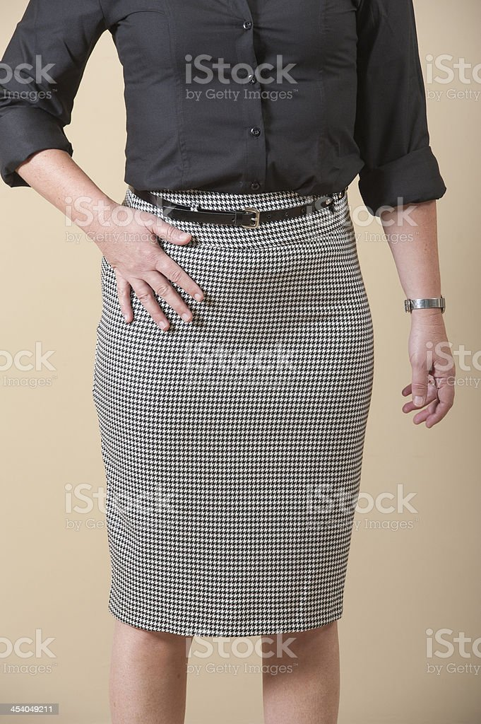 Closeup of womens skirt on biege background stock photo