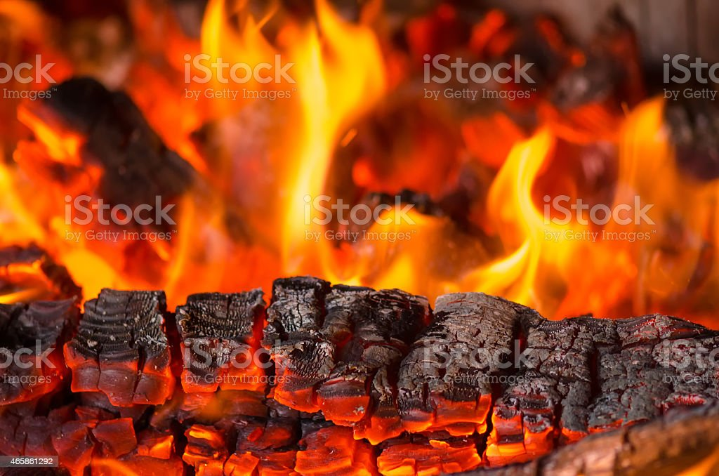 Close-up of wood becoming engulfed in flames stock photo