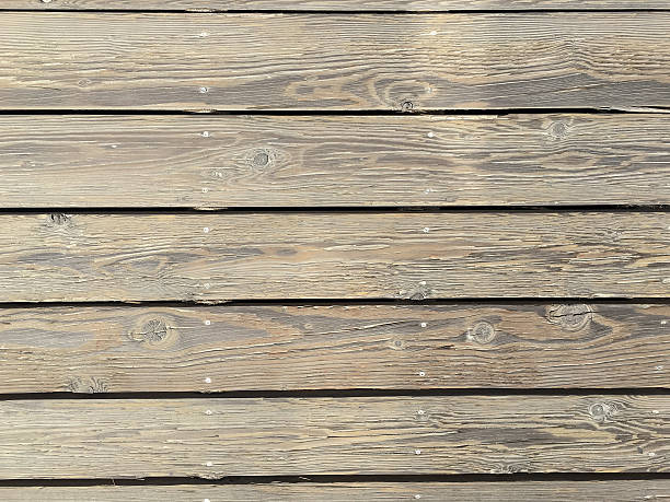 Close-up of wooden boardwalk at beach stock photo