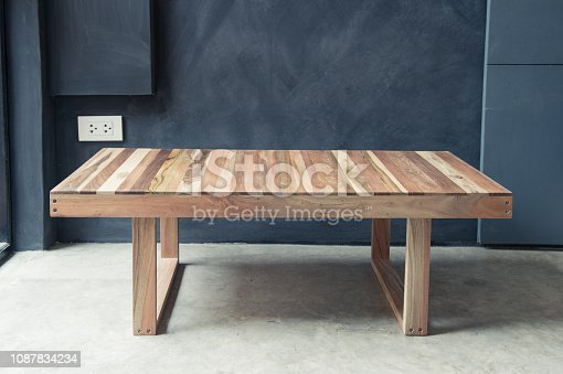 Closeup of wooden coffee table design for interior decorated