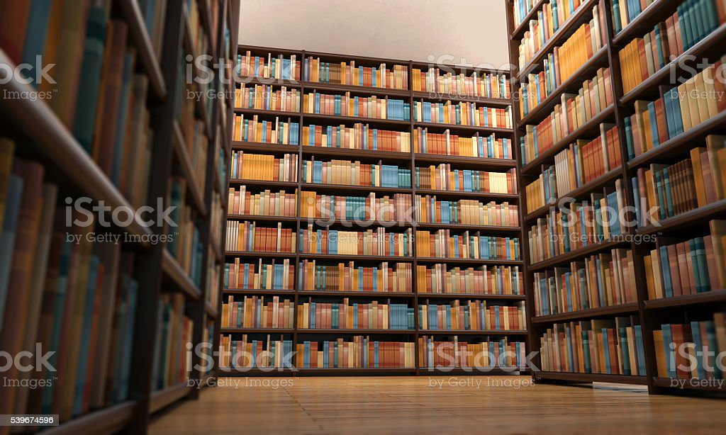 Close-up of wooden shelves full of books in library aisle stock photo
