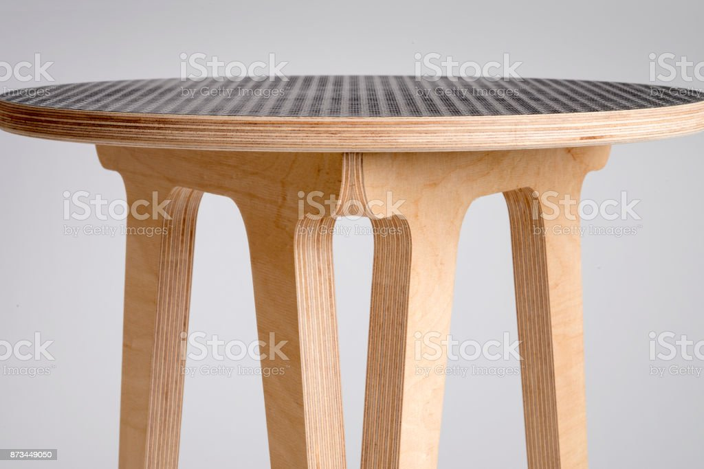 Closeup of Wooden Stool with Black Vinyl Covering on Top stock photo