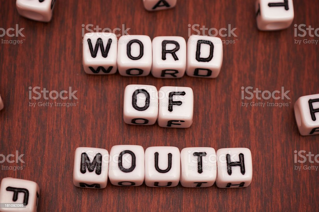 Close-up of word of mouth spelled out by beads royalty-free stock photo