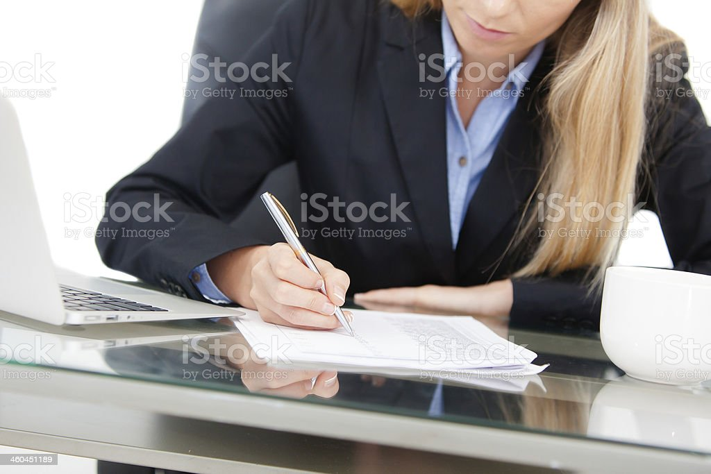 Close-up of working businesswoman at the desk stock photo