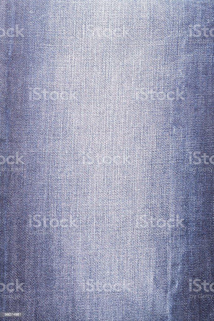 Closeup of worn blue jeans texture stock photo