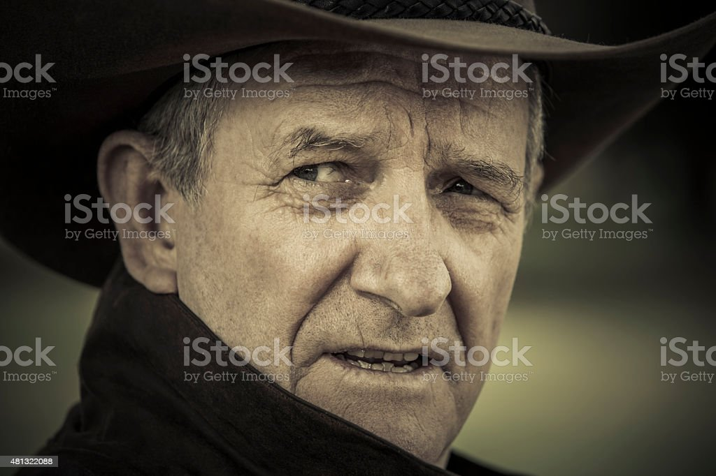 Close-up of worried stockman looking over shoulder stock photo