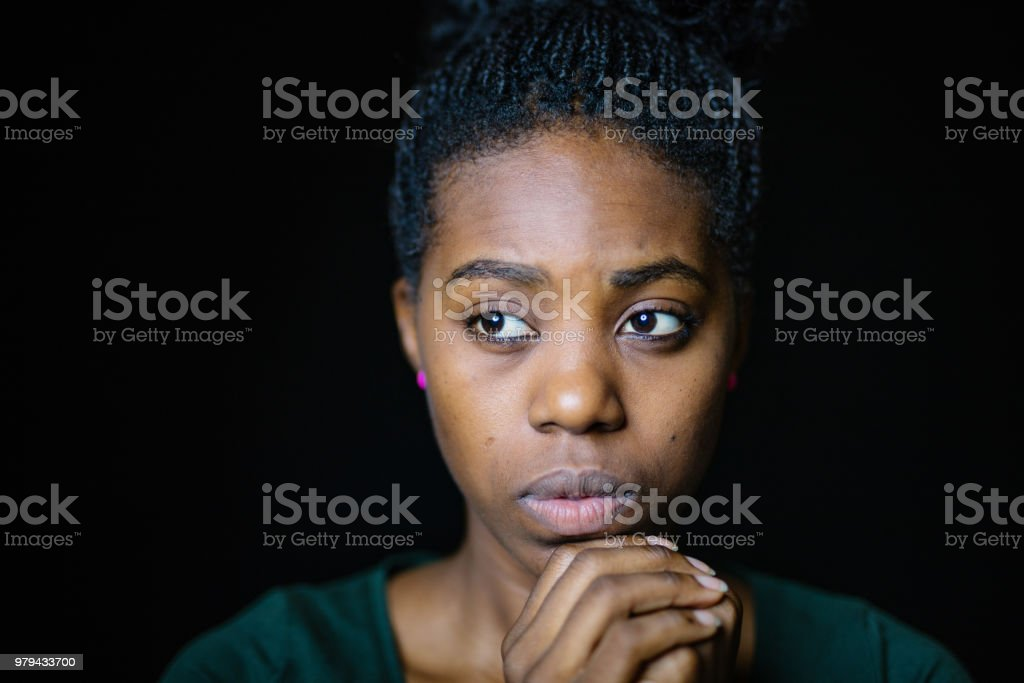 Close-Up Of Worried Woman Looking Away stock photo