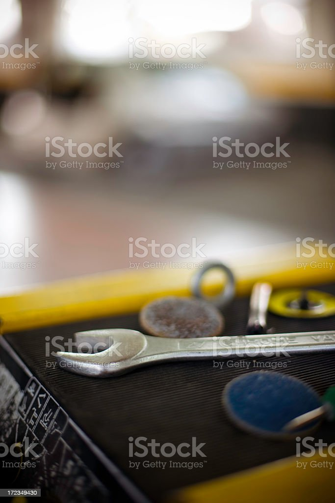 Close-up of wrench and tools against blurry background royalty-free stock photo