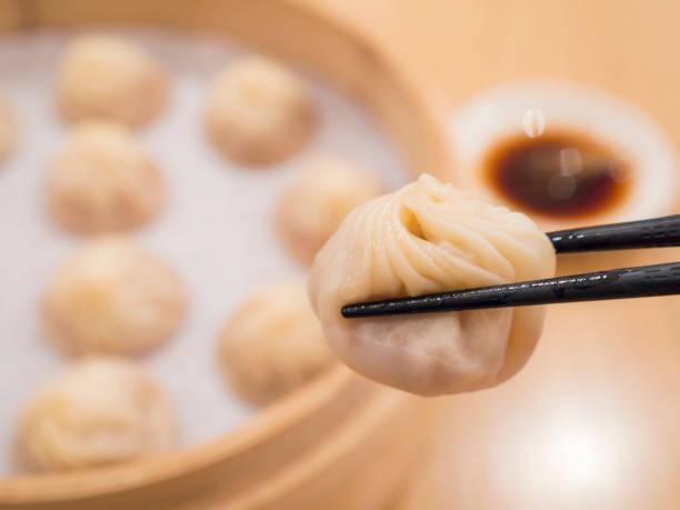 closeup of xiao long bao 1 - dumplings stock photos and pictures