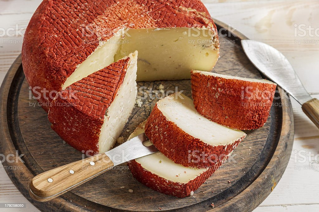 Closeup of yellow hard cheese with red wax royalty-free stock photo