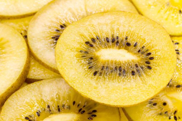 Close-up of yellow kiwi fruit Close-up of yellow kiwi fruit kiwi fruit stock pictures, royalty-free photos & images