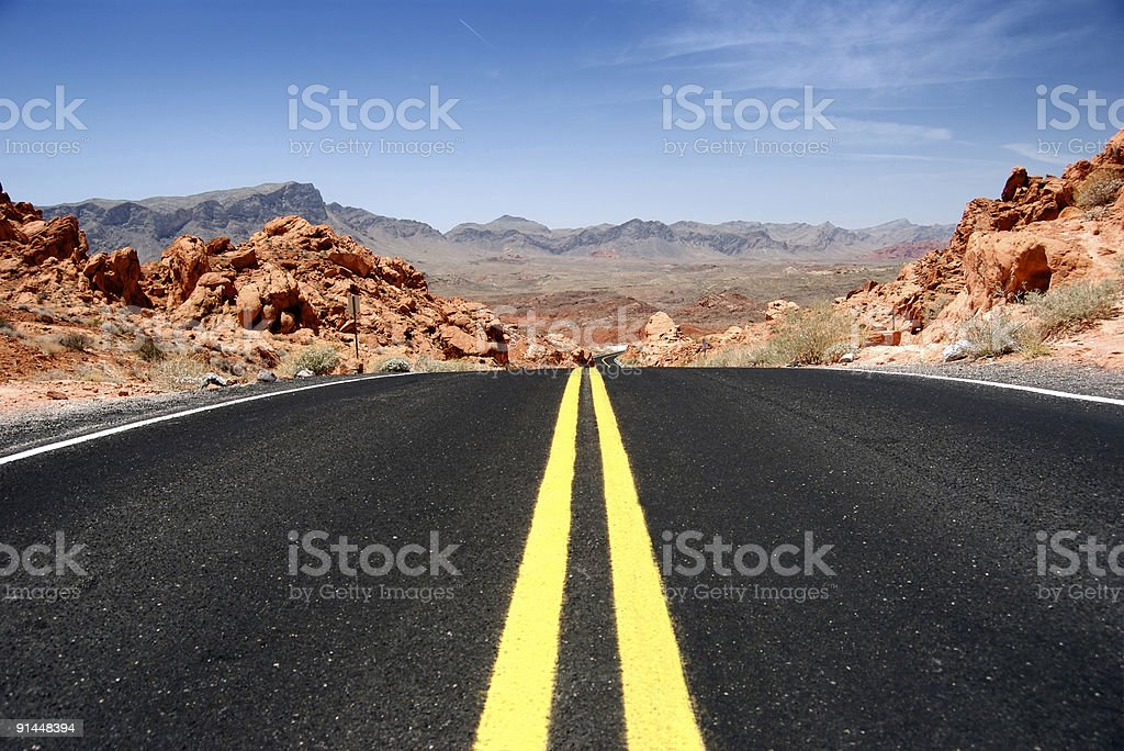Close-up of yellow lines on desert highway royalty-free stock photo
