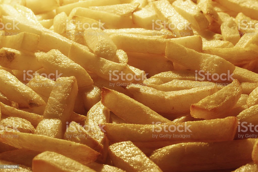 Close-up of yellow potato French fries royalty-free stock photo