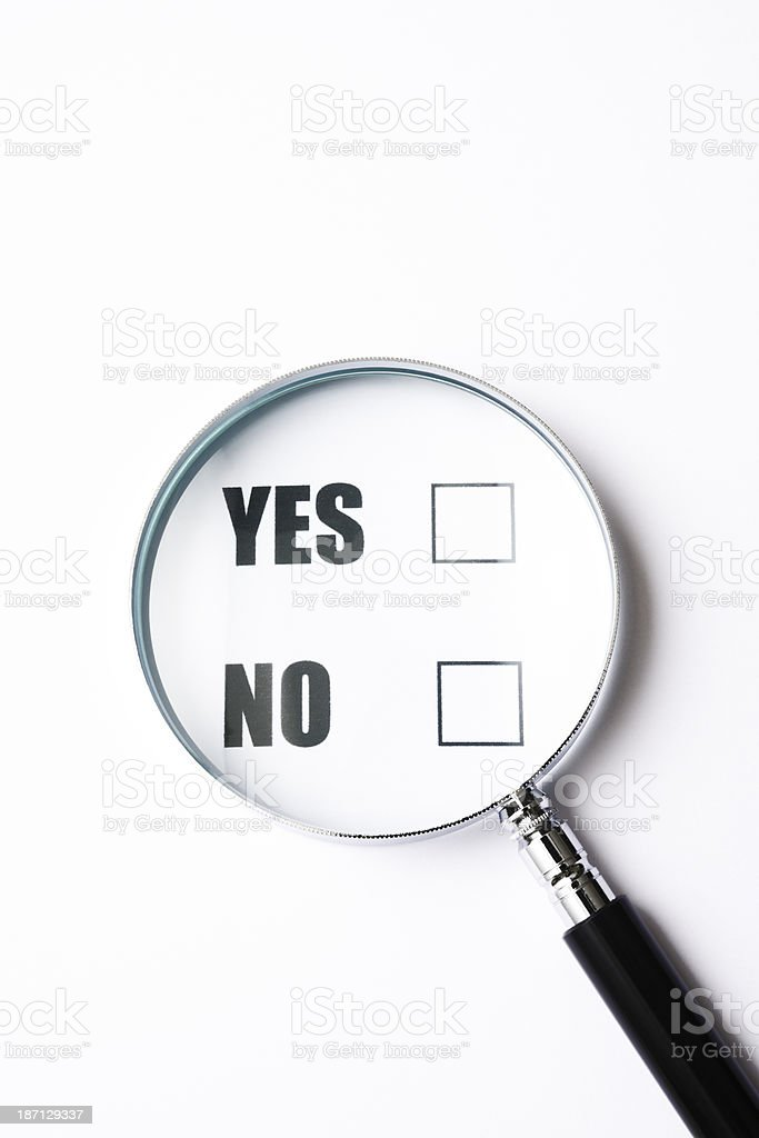 Close-up of YES or NO Check Box with magnifying glass royalty-free stock photo