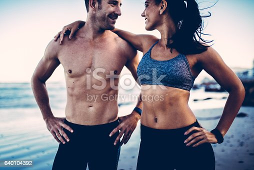 istock Close-up of young adult's muscular bodies 640104392