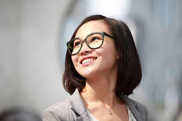 Closeup of young Asian businesswoman outdoors stock photo