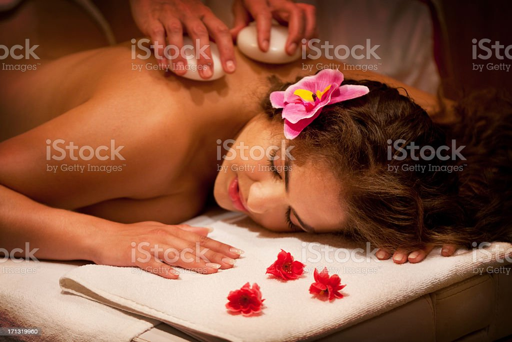 Close-up of Young Beautiful Relaxing Woman Having Stone Massage royalty-free stock photo