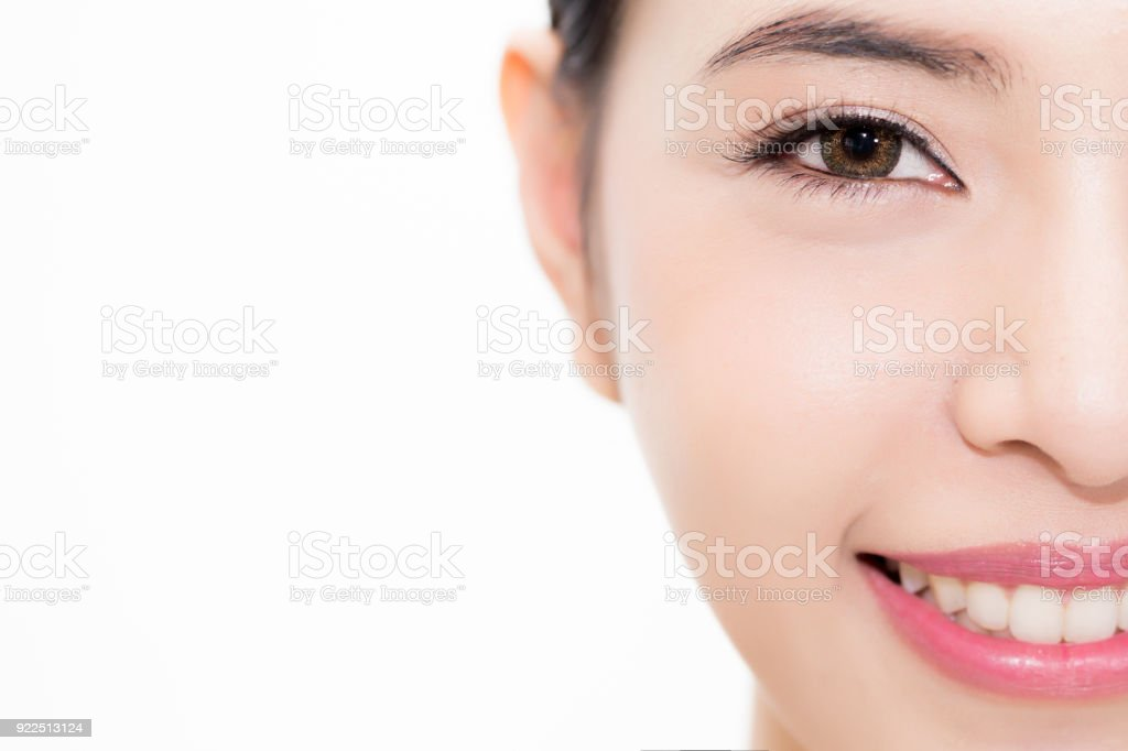 Close-up of Young beauty Asian face focused on eyes, beautiful woman isolated over white background. Healthcare and Eye care concept. stock photo