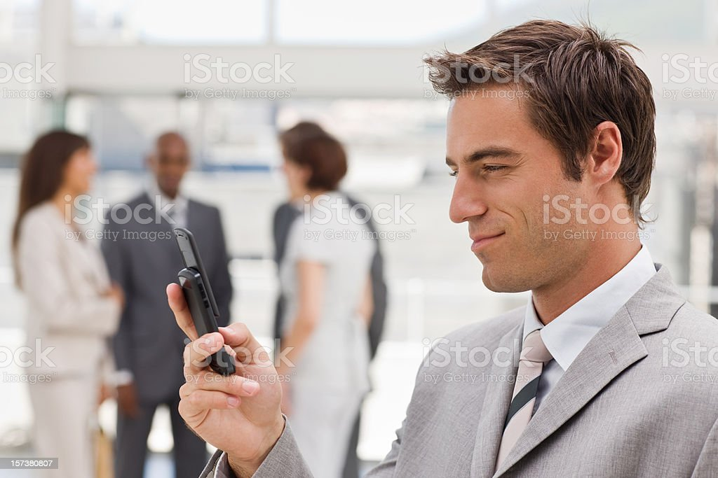 Closeup of young businessman text messaging royalty-free stock photo