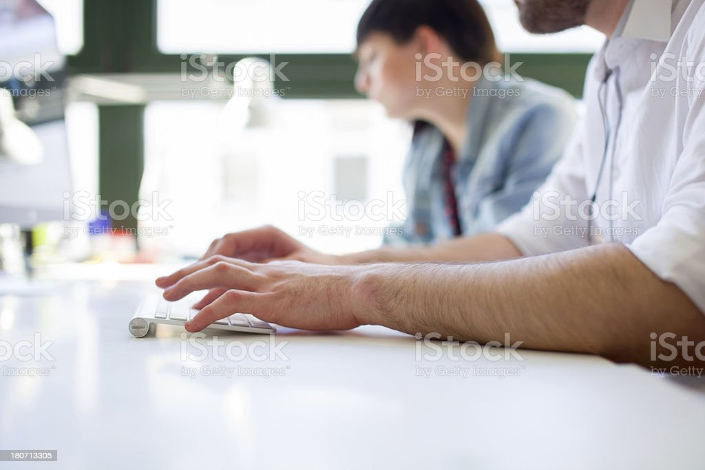 Closeup of Young Businessman typing on keyboard stock photo